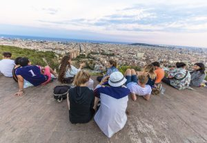 Barcelona, Spain - August 20, 2016: Group of people enjoy of a place to admire the scenery of Barcelona city, in the air-raid bunkers of the Carmel neighborhood