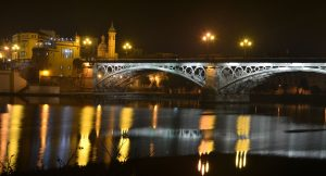 Isabel II Bridge in Seville, is called Triana Bridge too. Is an older iron bridge in Spain.