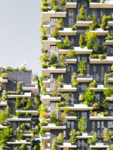 "Milan, Italy - September 19, 2015: ""Bosco Verticale"" (literally ""Vertical Forest"") is a complex of two residential towers in the modern district of Porta Nuova in Milan; their peculiarity is that they host hundreds of trees and plants in the facades."