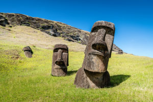 Easter Island Moai Statues at Rano Raraku under sunny summer sky. Rano Raraku, Rapa Nui National Park, Hanga Roa, Easter Island, Chile.