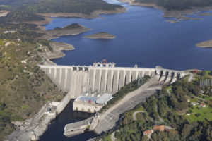 The Alcántara Dam, also known as the José María de Oriol Dam, is a buttress dam on the Tagus River near Alcántara in the province of Cáceres, Spain. It is named after the politician and captain of the Spanish electricity industry José María de Oriol y Urquijo. The dam regulates much of the flow of the Tagus River, the longest of the Iberian Peninsula. It was built in 1969 and is the second largest reservoir in Europe.